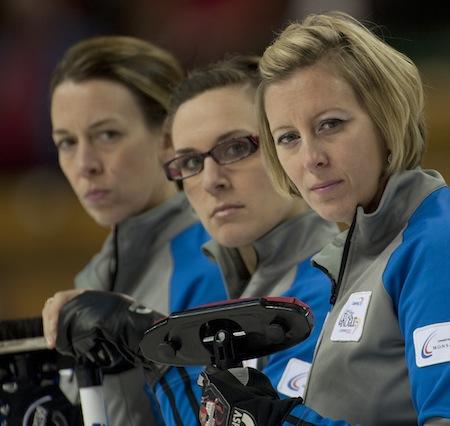 Teammates, from left, Jeanna Schraeder, Sarah Wazney and Sasha Carter of Team Scott assess the situation. (Photo, CCA/Michael Burns)