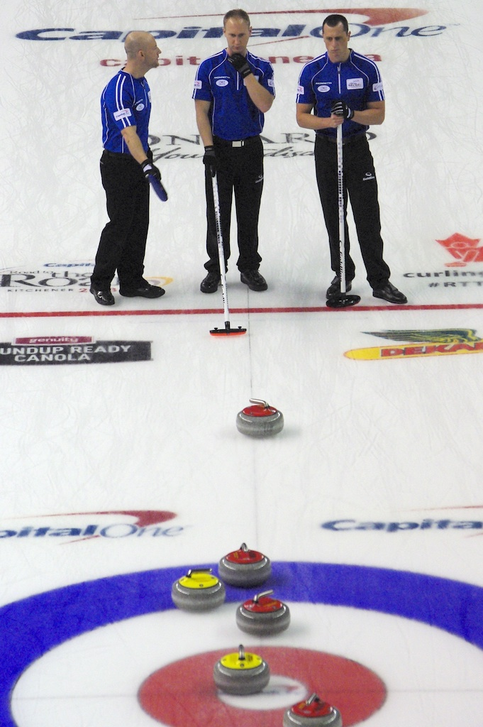 Brad Jacobs  discusses strategy with third Ryan Fry and second E.J. Harnden in Wednesday after action at the 2013 Capital One Road to the Roar in Kitchener (Photo CCA/A Sharp Eye Photography)
