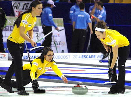 Skip Val Sweeting delivers rock to sweepers Rachel Pidherny, left, and Joanne Courtney. (Photo, CCA/Sharp Eye Photography)