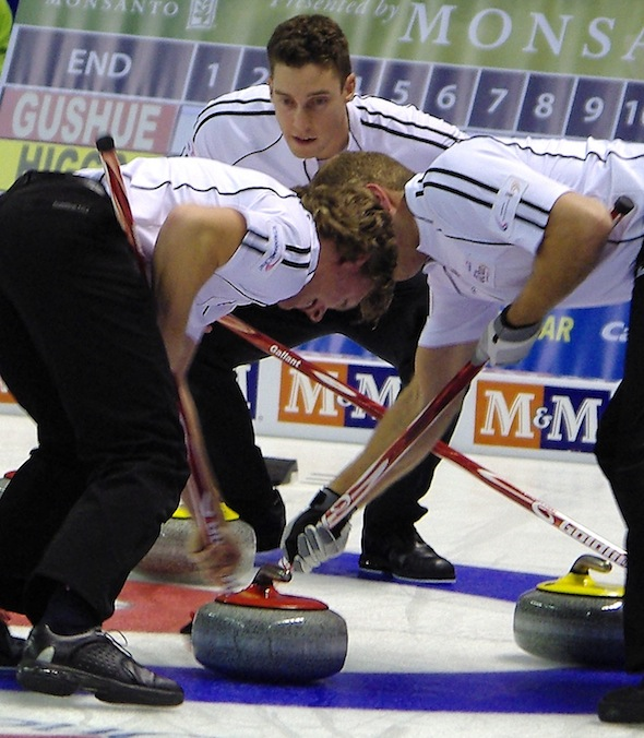 Team Gushue third Brett Gallant, top, urges on sweepers Adam Casey, left, and Geoff Walker on Wednesday night. (Photo, CCA/A Sharp Eye Photography)