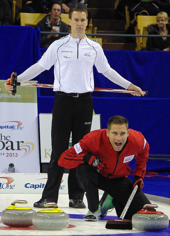 John Morris shouts instructions to his sweepers as Brad Gushue looks on during Thursday's A-Event final. (Photo, CCA/A Sharp Eye Photography)