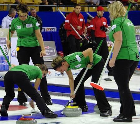 The Cathy Auld team works on a rock during action Thursday night at the Aud. (Photo, CCA/A Sharp Eye Photography)
