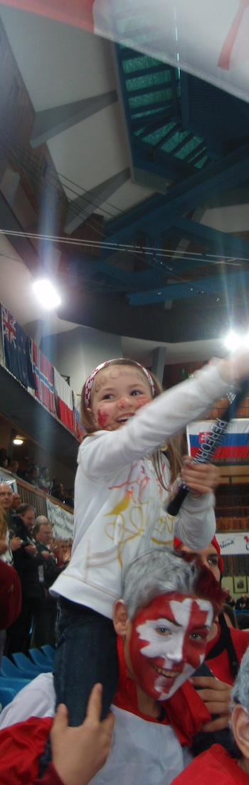 Nolan Thiessen's step-daughter Tyra waves the Canadian flag while sitting on the shoulders Jayden, the son of Team Koe second Carter Rycroft, at the 2010 World Championship. (Photo, courtesy Nolan Thiessen)