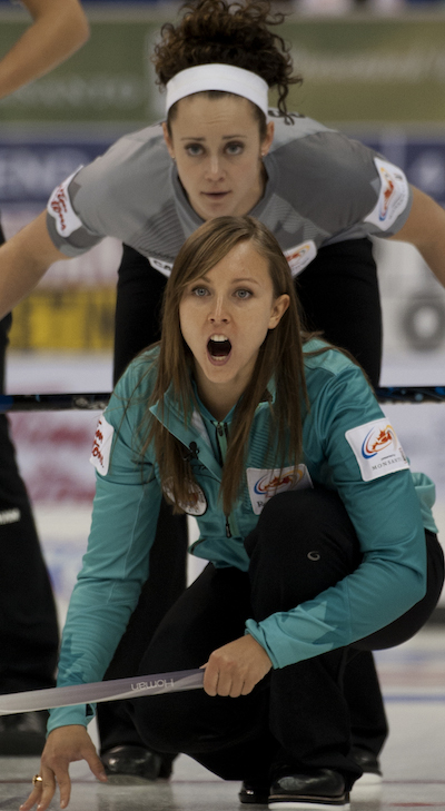 Ottawa's Rachel Homan guides her sweepers as Team Sweeting second Joanne Courtney looks on. (Photo, CCA/Michael Burns)