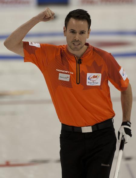 John Epping of Toronto celebrates his win over Kevin Koe of Calgary. (Photo, CCA/Michael Burns)