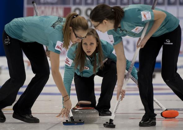Ottawa skip Rachel Homan delivers her rock to sweepers Alison Kreviazuk, left, and Lisa Weagle on Monday morning. (Photo, CCA/Michael Burns)
