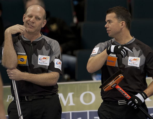 Edmonton's Kevin Martin, left, talks strategy with vice-skip David Nedohin during Monday afternoon's win over Jeff Stoughton. (Photo, CCA/Michael Burns)