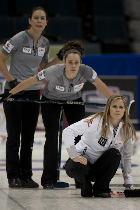 Jennifer Jones, right, ponders the situation as Team Sweeting lead Rachelle Pidherny, left, and second Joanne Courtney look on. (Photo, CCA/Michael Burns)