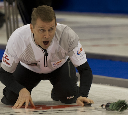 Winnipeg's Jeff Stoughton shouts directions to his sweepers. (Photo, CCA/Michael Burns)