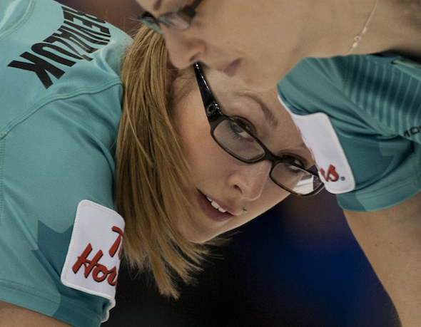 Team Homan sweepers Alison Kreviazuk, left, and Lisa Weagle work on a rock during Wednesday's win. (Photo, CCA/Michael Burns)