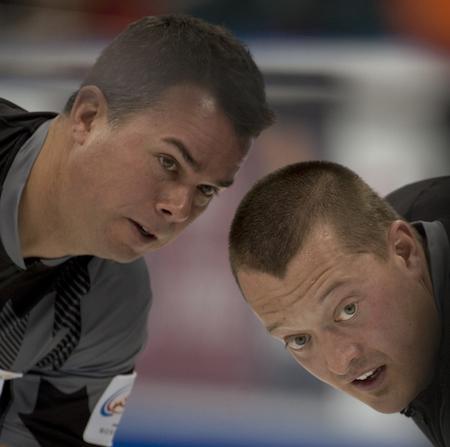 Team Martin sweepers David Nedohin, left, and Ben Hebert look for directions. (Photo, CCA/Michael Burns)