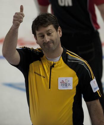 New Brunswick skip James Grattan celebrates his first win on Mondayt.