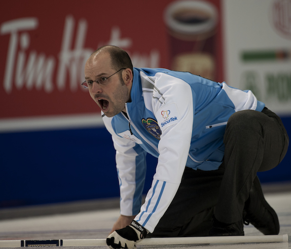 Quebec skip Jean-Michel Ménard guides his sweepers during his win over Manitoba on Tuesday. (Photos, CCA/Michael Burns)