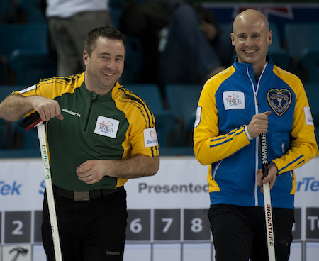 Northern Ontario skip Jeff Currie, left, and Alberta skip Kevin Koe share a laugh during Tuesday's game.
