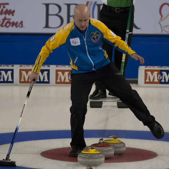 Alberta skip Kevin Koe shows some fancy footwork in the house during his team's win over Saskatchewan on Tuesday night. (Photos, CCA/Michael Burns)