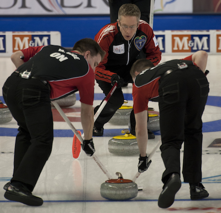 Ontario skip Greg Balsdon, top, instructs sweepers Mark Bice, left, and Jamie Farnell.