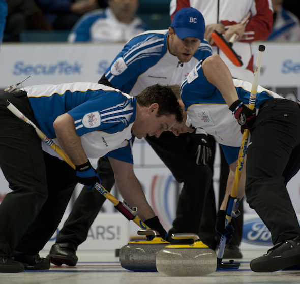Team B.C. vice-skip Jim Cotter, top, directs sweepers Rick Sawatsky, left, and Tyrel Griffith. (Photos, CCA/Michael Burns)