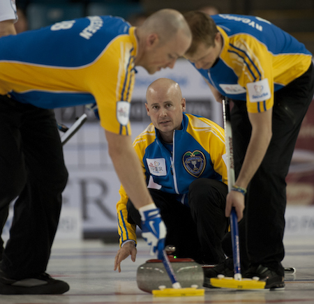 Alberta skip Kevin Koe, with sweepers Nolan Thiessen, left, and Carter Rycroft.