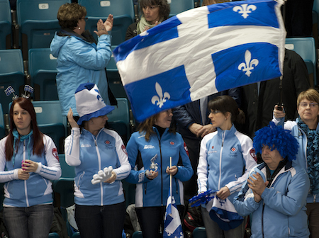 Quebec fans cheer on the Jean-Michel Ménard team during their game against Newfoundland/Labrador on Wednesday.