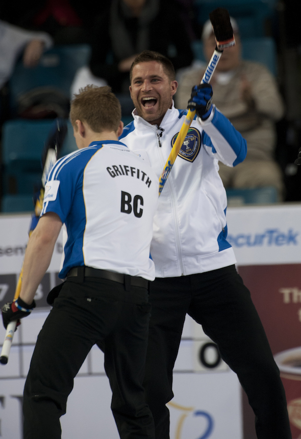 B.C. skip John Morris, right, and teammate Tyrel Griffith celebrate Jim Cotter's shot to score five in the third end against Ontario on Wednesday afternoon. (Photos, CCA/Michael Burns)