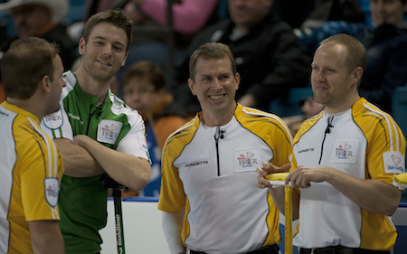 Saskatchewan's Kirk Muyres, second from left, shares a laugh with Manitoba's Reid Carruthers, left, Jeff Stoughton and Mark Nichols