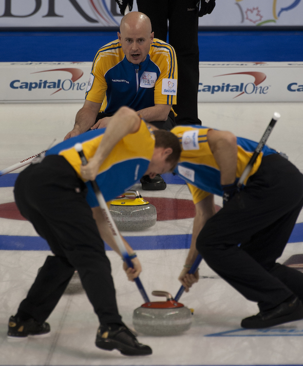 Alberta skip Kevin Koe, top, gives instructions to sweepers Carter Rycroft, left, and Pat Simmons. (Photos, CCA/Michael Burns)