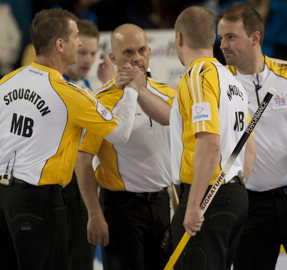 Team Manitoba celebrates its win over British Columbia on Thursday at the Tim Hortons Brier. (Photos, CCA/Michael Burns)