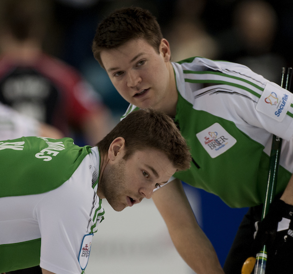 Saskatchewan brothers Dallan Muyres, top, and Kirk Muyres look for sweeping instructions during win over Ontario. (Photos, CCA/Michael Burns)