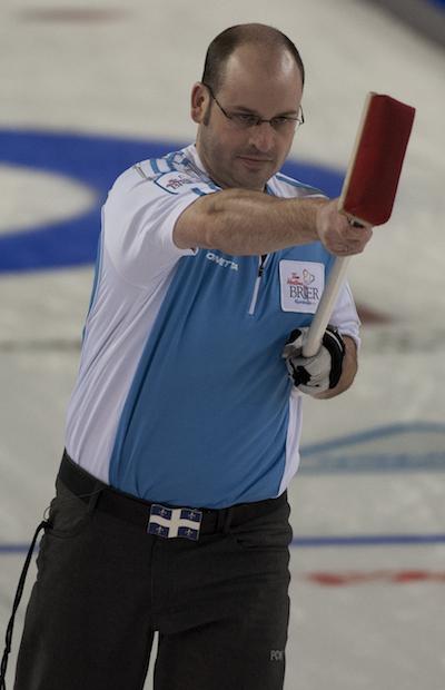 Quebec skip Jean-Michel Ménard celebrates a made shot on Thursday.