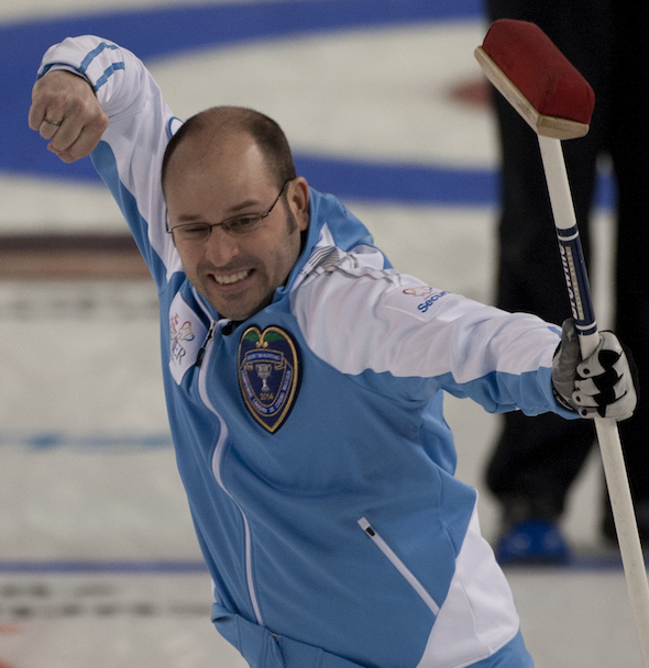 Quebec skip Jean-Michel Ménard celebrates during his playoff-clinching win over Alberta on Friday. (Photos, CCA/Michael Burns)