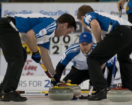 B.C. vice-skip Jim Cotter, middle, guides sweepers Rick Sawatsky, left, and Tyrel Griffith.