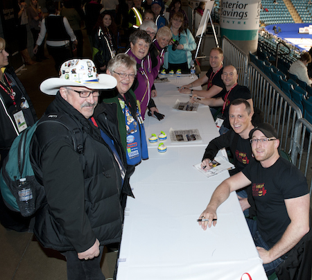 Team Jacobs, from top, skip Brad Jacobs, third Ryan Fry, second E.J. Harnden and lead Ryan Harnden sign autographs on Saturday at the Interior Savings Centre. They'll have another autograph session on Sunday at 3:30 p.m. Pacific Time at the ISC. (Photo, CCA/Michael Burns)