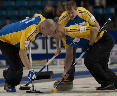 Alberta's Carter Rycroft, top, encourages sweepers Nolan Thiessen, left, and Pat Simmons. (Photo, CCA/Michael Burns)
