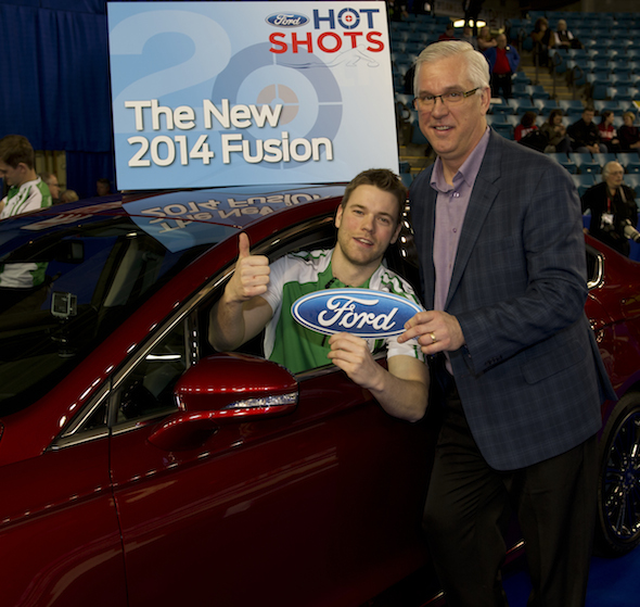 Saskatchewan's Kirk Muyres, left, accepts the keys to a Ford Fusion from Gerald Wood, General Manager, Western Region for Ford of Canada, on Saturday. (Photo, CCA/Michael Burns)