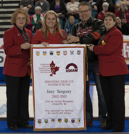Jany Tanguay, second from left, accepts the Asham Volunteer of the Year Award from Arnold Asham, accompanied by Canadian Curling Association governors Lena West, left, and Marilyn Neily. (Photo, CCA/Michael Burns)