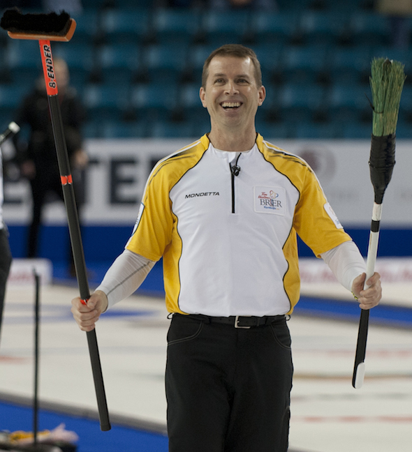Manitoba skip Jeff Stoughton leaves the ice with a smile after winning the bronze medal at the 2014 Tim Hortons Brier, presented by SecurTek. (Photo, CCA/Michael Burns)