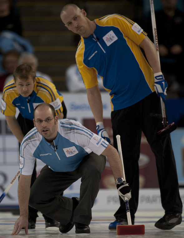 Quebec skip Jean-Michel Ménard watches his shot as Alberta's Carter Rycroft, left, and Nolan Thiessen look on. (Photo, CCA/Michael Burns)