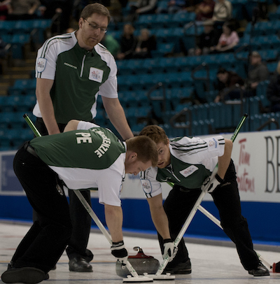 P.E.I. skip Eddie MacKenzie, top, directs sweepers Tyler MacKenzie, left, and Anson Carmody.