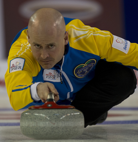 Alberta skip Kevin Koe focuses on his delivery during win over New Brunswick on Sunday.