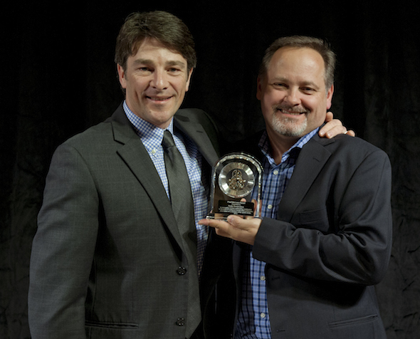 TSN curling producer Scott Higgins, left, presents Paul McLean award to winner Andy Bouyoukos. (Photo, CCA/Michael Burns)