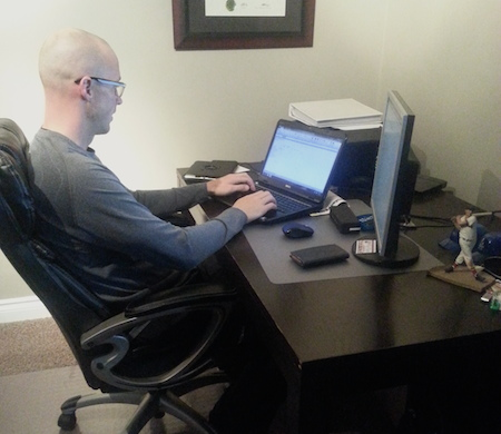 Nolan Thiessen works on the team budget spreadsheet in advance of the 2014-15 curling season. (Photo, Taylor Sinclair)