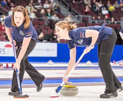 Sweepers Debbie McCormick, left, and Jessica Schultz look for instructions from Team North America skip Erika Brown during win over Team World's Satsuki Fujisawa.  (Photo, CCA/Chris Holloman, Katipo Creative)