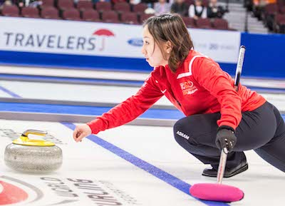 Team World's Satsuki Fujisawa delivers stone in mixed doubles victory on Thursday. (Photo, CCA/Chris Holloman, Katipo Creative)