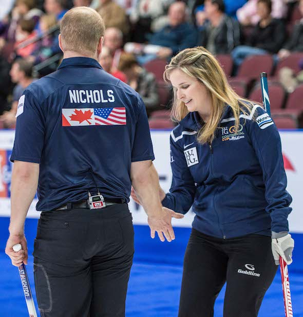 Mark Nichols, left, and Jennifer Jones exchange low-fives during their win over Niklas Edin and Christina Bertrup. (Photo, CCA/Chris Holloman, Katipo Creative)