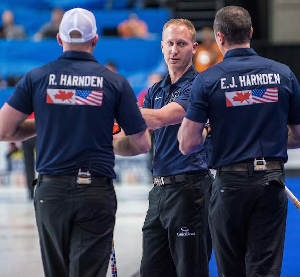 Team North America skip Brad Jacobs, middle, talks strategy with teammates Ryan Harnden, left, and E.J. Harnden. (Photo, CCA/Chris Holloman, Katipo Creative)