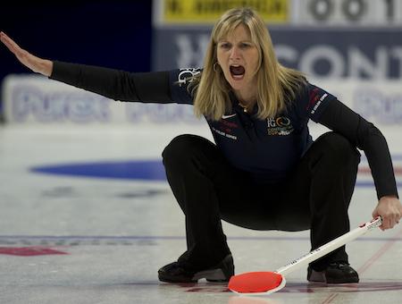 Team North America skip Erika Brown instructs her sweepers. (Photo, CCA/Michael Burns)