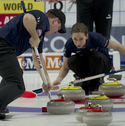 Team North America's Jessica Schultz, right, encourages teammate John Shuster. (Photo, CCA/Michael Burns)