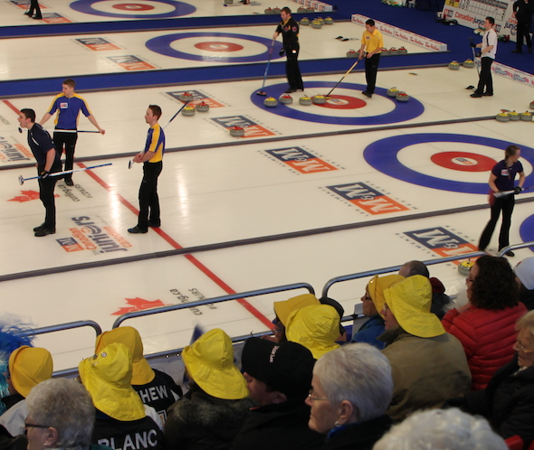Nova Scotia fans (in yellow sou'wester hats) take in Tuesday afternoon's draw at Queens Place Emera Centre. (Photo, CCA)