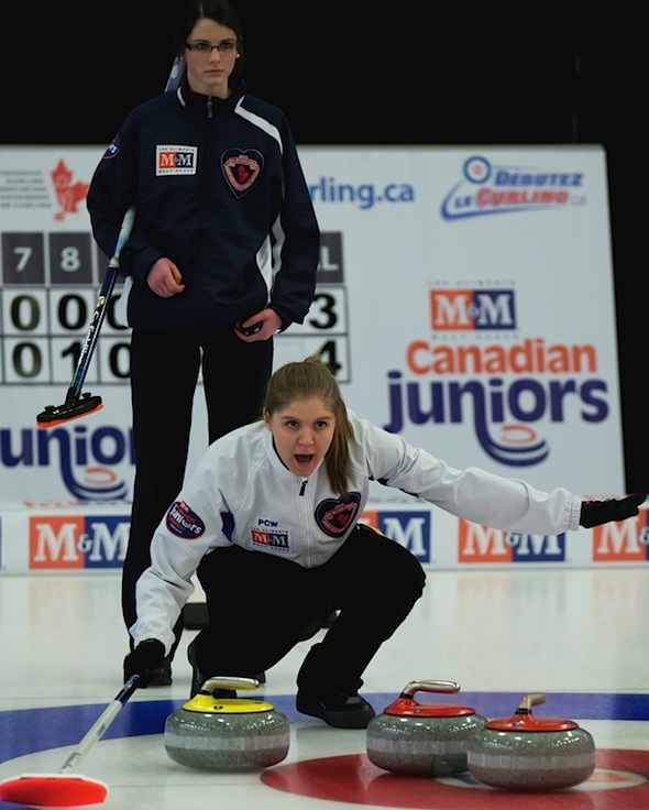 B.C. skip Kalia Van Osch, front, calls instructions to sweepers as Nova Scotia skip Mary Fay looks on during the women's semifinal on Saturday. (Photo, CCA/Mark O'Neill/Michael Burns Photography)