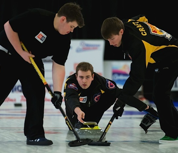 New Brunswick skip René Comeau delivers rock to sweepers Ryan Freeze, left, and Jordan Craft during Sunday's semifinal. (Photo, CCA/Michael Burns Photography/Mark O'Neill)